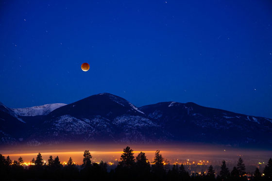 Lunar eclipse over mountains